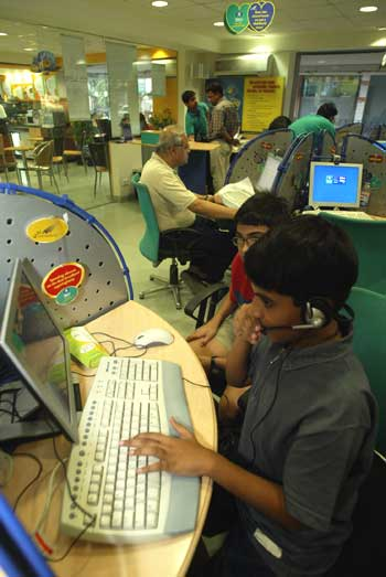 Children play computer games at a high-speed broadband internet cafe.