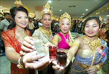Contestants pose during a drinking competition for women at a mall in Bangkok.