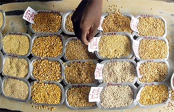 A man arranges price tags on various pulses at a market in Chennai, July 14, 2009.