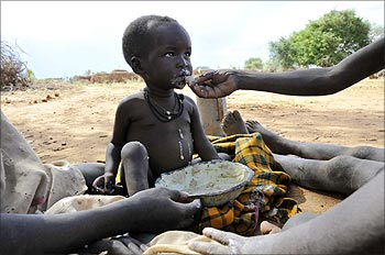 A malnourished child is fed a meal in Uganda's Karamoja region.