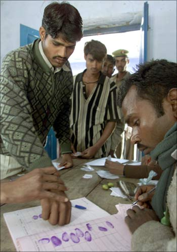 A voter registers his vote using his fingerprint.
