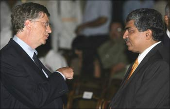 Microsoft Corp co-founder Bill Gates speaks with Nandan Nilekani.