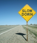 Slow down signpost