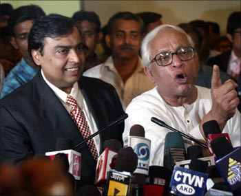 Former West Bengal Chief Minister Buddhadev Bhattacharjee with industrialist Mukesh Ambani in Kolkata.