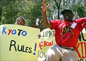 People demonstrate against the US refusal to ratify the Koyoto protocol outside US consulate in Johannesburg, South Africa.