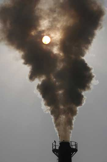 Smoke rises from a chimney of a garbage processing plant at Daddumajra village on the outskirts of Chandigarh.