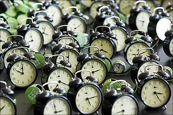 Clocks are seen during the performance - tck tck tck -- by Global Campaign for Climate Action at the Barcelona Climate Change Talks.