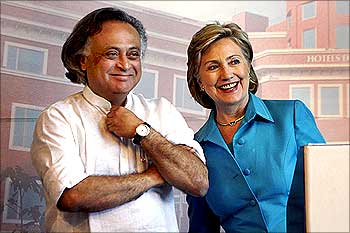 US Secretary of State Hillary Clinton shares a moment with Jairam Ramesh (L), Indian Minister of State (MOS) for Environment and Forests in Gurgaon.