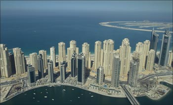 A view of Jumeirah Beach Residence in Dubai, with the Palm Island Jumeirah in the background.