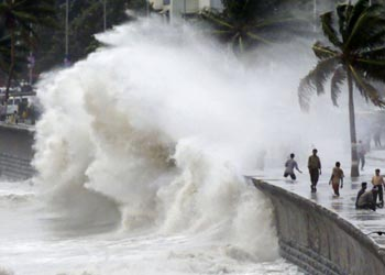 Giant waves lash Mumbai as a cyclonic storm hovered in the Arabian Sea.