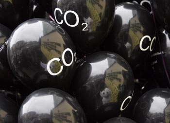 Protesters reflected in balloons as they demonstrate against CO2 emissions in Kiev.