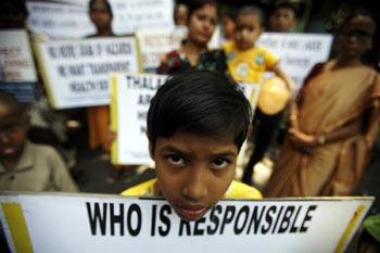A child participates in an awareness campaign on climate change.