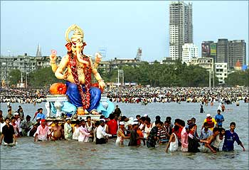 Devotees carry a statue of elephant headed god Ganesh for its immersion into the Arabian Sea in Mumbai.