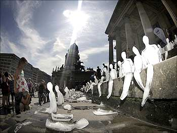 Ice sculptures in the shape of humans are placed on the steps of the music hall in Gendarmenmarkt public square in Berlin.