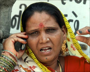 A woman talks on aa mobile phone.