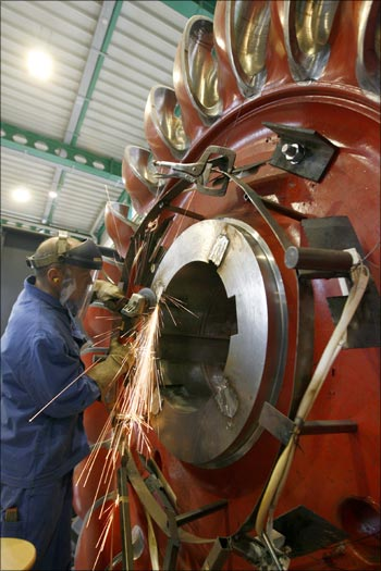 A worker grinds the wheel of a turbine at a plant of Grimsel Hydro.
