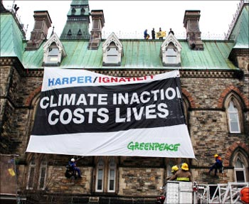 A Greenpeace banner on climate inaction.