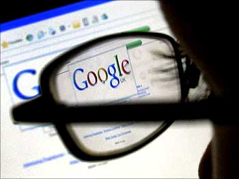 A Google search page is seen through the spectacles of a computer user in Leicester.