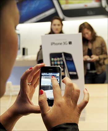 A customer tries the Apple iPhone 3GS at the company's retail store in San Francisco.