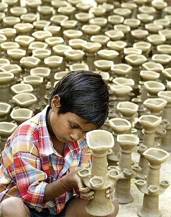 An artisan makes earthen lamps at a workshop ahead of the Hindu festival of Diwali in Amritsar.