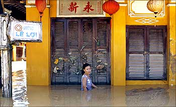 A woman wades through flood waters caused by Typhoon Ketsana in Vietnam.