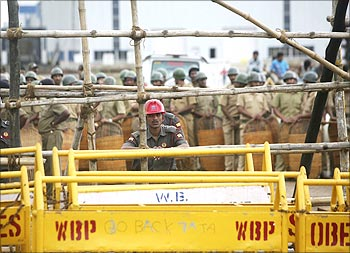 Tata Motors security personnel and policemen stand guard at Singur factory.