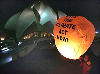 A sky lantern floats in front of the Bahai Mashriqu'l-Adhkar, or the Lotus Temple, during an environment awareness programme in New Delhi.