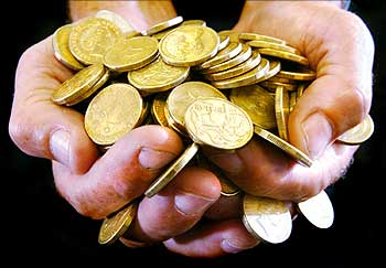 A handful of gold dollar coins.