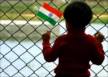 A young girl holds Indian national flag during the India's Independence Day.