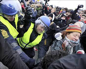 Police clash with protesters at a roadblock near the venue of the United Nations Climate Change Conference 2009 in Copenhagen.