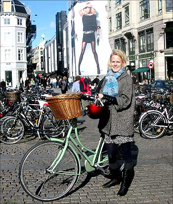 Louise Kristensen, a 24-year-old student, stands with her bicycle in central Copenhagen. Nearly 40 percent of Copenhagen's population cycle to work or school on ubiquitous paved cycle paths