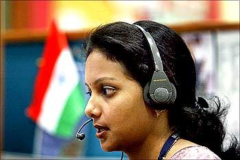 Indian employee at call centre provides international customer support in Bangalore.