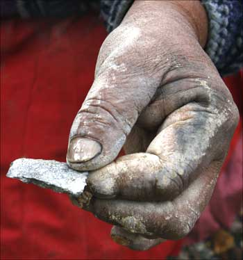 Bolivian indigenous woman Felipa holds a piece of silver ore in Potosi.