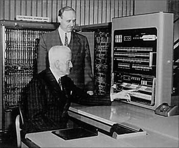 Thomas Watson, Sr. (seated) the CEO of IBM in 1952 using the IBM 701 computer, the company's first fully electronic model.