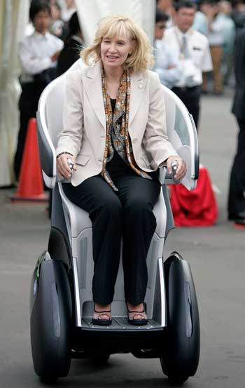 Canadian PM Stephen Harper's wife Laureen rides a Toyota Motor Corp i-REAL concept vehicle.