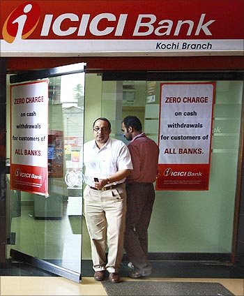 A man leaves an ATM facility of ICICI bank in the southern Indian city of Kochi.