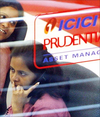 An employee of life insurance company, ICICI Prudential, speaks on a phone in Mumbai.