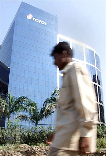 A man walks past the ICICI headquarters in Mumbai.