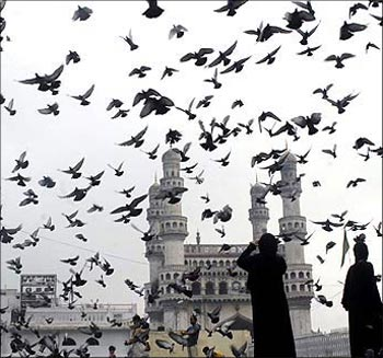 Image: Pigeons fly against the backdrop of the historic Charminar monument in Hyderabad. Photograph: Krishnendu Halder/Reuters