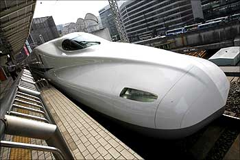 Japan Railway's new N700 bullet train stands at a platform of Tokyo Station in Tokyo.