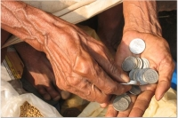An old man counts his money