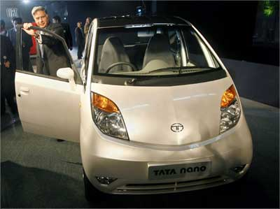 Tata Group chairman Ratan Tata poses with the Nano. | Photograph: Adnan Abidi/Reuters n