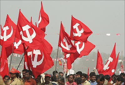 Communist Party of India (Marxist) supporters hold their party flags