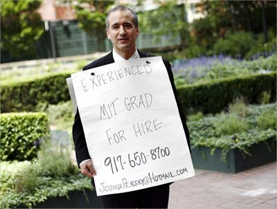 Joshua Persky, desperate to find a job, stands with his sandwich board advertisement in New York. | Photograph: Shannon Stapleton/Reuters
