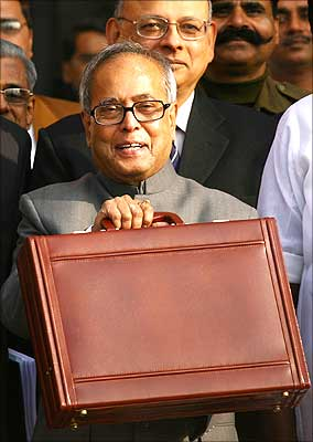 Pranab Mukherjee, India's foreign minister and acting finance minister, smiles as he leaves his office to present the 2009/10 interim budget in New Delhi on February 16, 2009. | Photograph: Vijay Mathur/Reuters