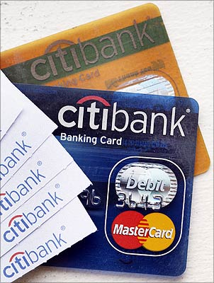 Citibank regular and gold bank cards, along with several ATM receipts, are seen in this photo illustration taken in New York.