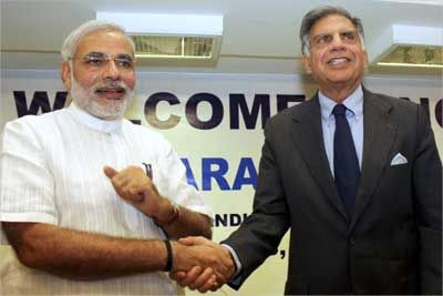 Tata Group Chairman Ratan Tata (R) shakes hands with Gujarat's Chief Minister Narendra Modi in Ahmedabad. | Photograph: REUTERS/Amit Dave