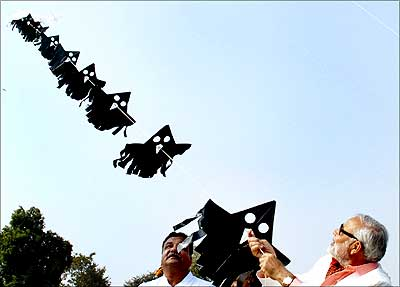 Gujarat Chief Minister Narendra Modi flies a kite in Ahmedabad. | Photograph: Amit Dave/Reuters