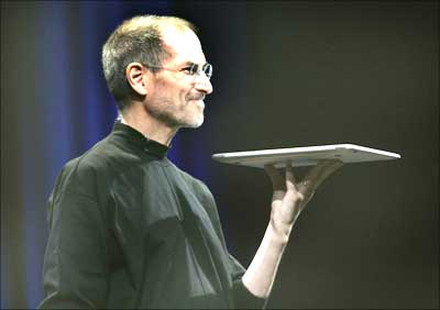 Steve Jobs holds Apple's new Macbook Air notebook computer.