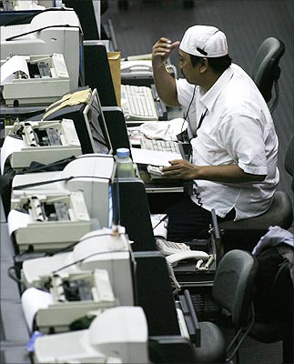 A broker speaks on the phone during a trading session at the Indonesia Stock Exchange.